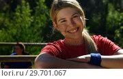 Купить «Portrait of female trainer leaning on wooden frame during obstacle course», видеоролик № 29701067, снято 16 марта 2017 г. (c) Wavebreak Media / Фотобанк Лори