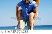 Купить «Couple enjoying together at beach», видеоролик № 29701295, снято 17 января 2017 г. (c) Wavebreak Media / Фотобанк Лори