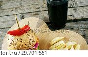 Hamburger, french fries and cold drink on wooden board. Стоковое видео, агентство Wavebreak Media / Фотобанк Лори