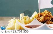 Купить «Onion ring and french fries with ketchup arranged in plate», видеоролик № 29701555, снято 13 января 2017 г. (c) Wavebreak Media / Фотобанк Лори