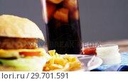 Купить «Snacks and cold drink on wooden table», видеоролик № 29701591, снято 13 января 2017 г. (c) Wavebreak Media / Фотобанк Лори