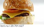 Купить «Hamburger on white background», видеоролик № 29701627, снято 13 января 2017 г. (c) Wavebreak Media / Фотобанк Лори