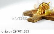 Купить «Snacks with dip on chopping board», видеоролик № 29701635, снято 13 января 2017 г. (c) Wavebreak Media / Фотобанк Лори