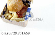 Hamburger and french fries in a take away container on table. Стоковое видео, агентство Wavebreak Media / Фотобанк Лори