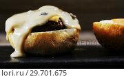 Купить «Melted cheese over hamburger on tray», видеоролик № 29701675, снято 13 января 2017 г. (c) Wavebreak Media / Фотобанк Лори