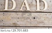 Купить «Text dad on wooden plank», видеоролик № 29701683, снято 13 января 2017 г. (c) Wavebreak Media / Фотобанк Лори
