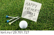 Купить «Happy fathers day message with sports equipments», видеоролик № 29701727, снято 13 января 2017 г. (c) Wavebreak Media / Фотобанк Лори