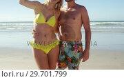 Купить «Couple taking selfie on mobile phone at beach», видеоролик № 29701799, снято 1 марта 2017 г. (c) Wavebreak Media / Фотобанк Лори