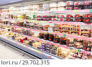 Купить «Showcase with different fresh sweet cakes ready to sale in hypermarket», фото № 29702315, снято 27 января 2018 г. (c) FotograFF / Фотобанк Лори