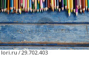 Купить «Color pencils arranged on wooden table», видеоролик № 29702403, снято 5 апреля 2017 г. (c) Wavebreak Media / Фотобанк Лори