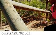 Купить «Woman exercising on outdoor equipment during obstacle course», видеоролик № 29702563, снято 16 марта 2017 г. (c) Wavebreak Media / Фотобанк Лори