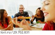 Купить «Happy executives sharing pizza in conference room», видеоролик № 29702831, снято 26 марта 2017 г. (c) Wavebreak Media / Фотобанк Лори