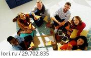 Купить «Group of happy executives having pizza in office», видеоролик № 29702835, снято 26 марта 2017 г. (c) Wavebreak Media / Фотобанк Лори