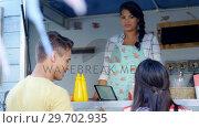 Купить «Man paying bill through mobile phone», видеоролик № 29702935, снято 26 марта 2017 г. (c) Wavebreak Media / Фотобанк Лори
