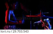Купить «Female drummer playing on drum set 4k», видеоролик № 29703543, снято 7 марта 2017 г. (c) Wavebreak Media / Фотобанк Лори