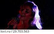 Купить «Female singer singing into a microphone 4k», видеоролик № 29703563, снято 7 марта 2017 г. (c) Wavebreak Media / Фотобанк Лори