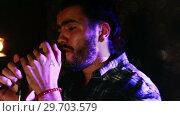 Купить «Male singer singing into a microphone 4k», видеоролик № 29703579, снято 7 марта 2017 г. (c) Wavebreak Media / Фотобанк Лори