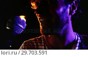 Купить «Male singer singing into a microphone 4k», видеоролик № 29703591, снято 7 марта 2017 г. (c) Wavebreak Media / Фотобанк Лори