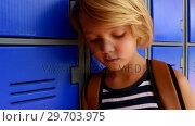 Купить «Schoolgirl using mobile phone in locker room 4k», видеоролик № 29703975, снято 11 марта 2017 г. (c) Wavebreak Media / Фотобанк Лори
