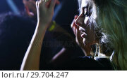 Купить «Woman dancing and giving a flying kiss at a concert 4k», видеоролик № 29704247, снято 7 марта 2017 г. (c) Wavebreak Media / Фотобанк Лори