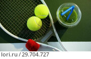 Купить «Juice and sports equipment in tennis court 4k», видеоролик № 29704727, снято 6 апреля 2017 г. (c) Wavebreak Media / Фотобанк Лори