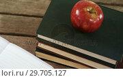 Купить «Apple on book stack 4k», видеоролик № 29705127, снято 26 мая 2017 г. (c) Wavebreak Media / Фотобанк Лори