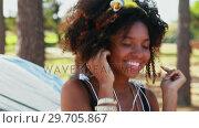 Купить «Woman listening to headphones 4k», видеоролик № 29705867, снято 9 марта 2017 г. (c) Wavebreak Media / Фотобанк Лори
