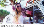 Купить «Happy woman raising hands out of car window 4k», видеоролик № 29705903, снято 9 марта 2017 г. (c) Wavebreak Media / Фотобанк Лори