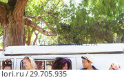 Купить «Friends using mobile phone near camper van in park 4k», видеоролик № 29705935, снято 9 марта 2017 г. (c) Wavebreak Media / Фотобанк Лори