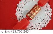 Christmas cracker on table 4k. Стоковое видео, агентство Wavebreak Media / Фотобанк Лори
