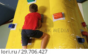 Купить «Boy climbing bouncy castle 4k», видеоролик № 29706427, снято 25 апреля 2017 г. (c) Wavebreak Media / Фотобанк Лори