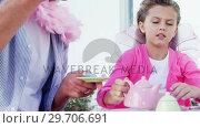 Купить «Smiling father and daughter in fairy costume having a tea party 4k», видеоролик № 29706691, снято 24 марта 2017 г. (c) Wavebreak Media / Фотобанк Лори