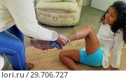 Купить «Grandmother helping granddaughter to wear shoes in bedroom 4k», видеоролик № 29706727, снято 24 марта 2017 г. (c) Wavebreak Media / Фотобанк Лори