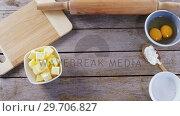 Купить «Butter cubes and egg yolk on a wooden table 4k», видеоролик № 29706827, снято 5 мая 2017 г. (c) Wavebreak Media / Фотобанк Лори