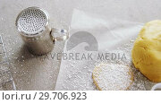 Купить «Raw heart shape cookies on baking tray with flour shaker strainer, cookie cutter and wax paper 4k», видеоролик № 29706923, снято 5 мая 2017 г. (c) Wavebreak Media / Фотобанк Лори