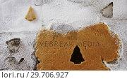 Купить «Cookies cutter being used to cut the dough 4k», видеоролик № 29706927, снято 5 мая 2017 г. (c) Wavebreak Media / Фотобанк Лори