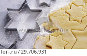 Купить «Raw cookie dough with star shape and cutter 4k», видеоролик № 29706931, снято 5 мая 2017 г. (c) Wavebreak Media / Фотобанк Лори