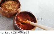 Cinnamon powder and red chili powder in bowl 4k. Стоковое видео, агентство Wavebreak Media / Фотобанк Лори