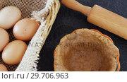 Купить «Eggs in wicker basket with dough 4k», видеоролик № 29706963, снято 5 мая 2017 г. (c) Wavebreak Media / Фотобанк Лори