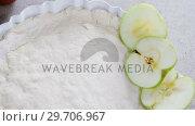 Купить «Raw tart with slice apple on table 4k», видеоролик № 29706967, снято 5 мая 2017 г. (c) Wavebreak Media / Фотобанк Лори