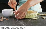 Купить «Woman slicing off extra dough from the mold 4k», видеоролик № 29707027, снято 5 мая 2017 г. (c) Wavebreak Media / Фотобанк Лори