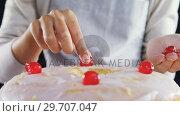Купить «Woman topping a fresh baked cake with cherry 4k», видеоролик № 29707047, снято 5 мая 2017 г. (c) Wavebreak Media / Фотобанк Лори