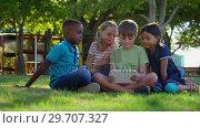 Купить «Kids using digital tablet in the playground 4k», видеоролик № 29707327, снято 28 марта 2017 г. (c) Wavebreak Media / Фотобанк Лори