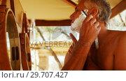 Купить «Man shaving his beard with razor in cottage 4k», видеоролик № 29707427, снято 12 мая 2017 г. (c) Wavebreak Media / Фотобанк Лори