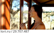 Купить «Woman looking through binoculars on safari vacation 4k», видеоролик № 29707487, снято 12 мая 2017 г. (c) Wavebreak Media / Фотобанк Лори