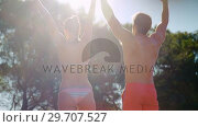 Купить «Couple having fun together near poolside 4k», видеоролик № 29707527, снято 12 мая 2017 г. (c) Wavebreak Media / Фотобанк Лори