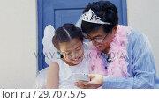 Купить «Father and daughter in fairy costume taking a selfie with mobile phone 4k», видеоролик № 29707575, снято 20 марта 2017 г. (c) Wavebreak Media / Фотобанк Лори