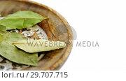 Купить «Bay leaf in a plate 4k», видеоролик № 29707715, снято 5 июня 2017 г. (c) Wavebreak Media / Фотобанк Лори
