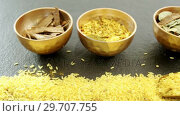Купить «Various spices in bowl with yellow rice 4k», видеоролик № 29707755, снято 5 июня 2017 г. (c) Wavebreak Media / Фотобанк Лори