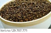 Купить «Black peppers in bowl 4k», видеоролик № 29707771, снято 5 июня 2017 г. (c) Wavebreak Media / Фотобанк Лори